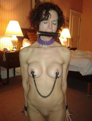 Corded up naked mature..